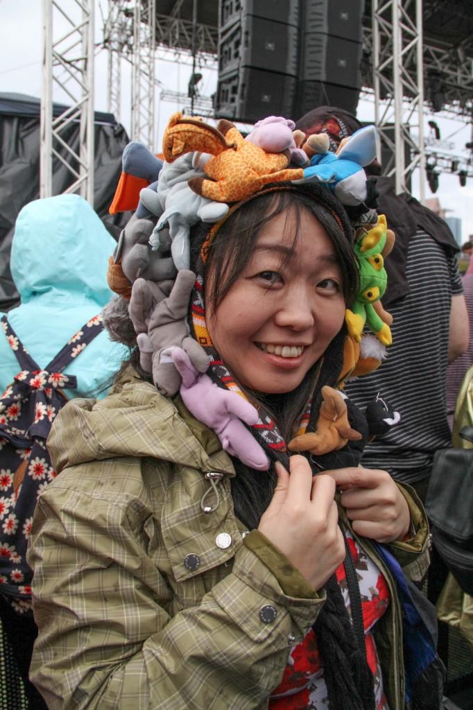 A festival-goer wears a crazy animal helmet at Toro Y Moi.