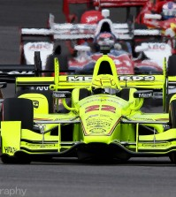 May 14, 2016 | Speedway, IN: Race-winner Simon Pagenaud (#22) leads the IndyCar field late-race.